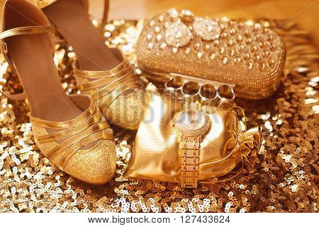 Golden. Women Clothes And Accessories. Luxury Jewelry. Fashion Diamond Earrings And Golden Wristwatc