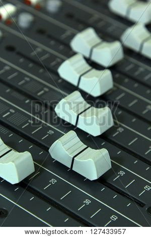 Closeup buttons equipment in audio mixing console