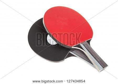 Pair of ping-pong rackets and white ball isolated on white background