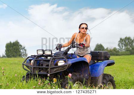 Elegant Woman Riding Quadrocycle