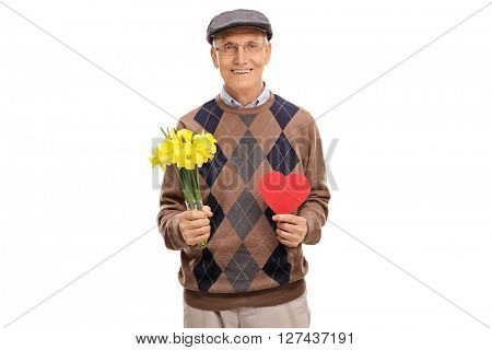 Lovely old man holding a bunch of yellow tulips and a small heart isolated on white background