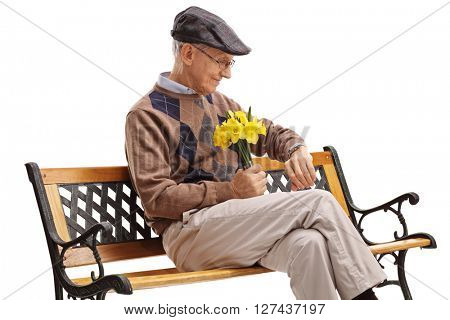 Romantic senior sitting on a bench and waiting for his date isolated on white background