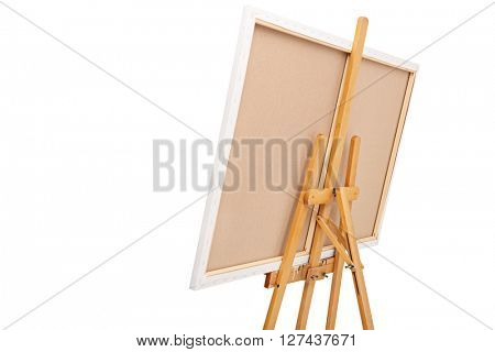 Rear view studio shot of a wooden easel with a canvas on it isolated on white background