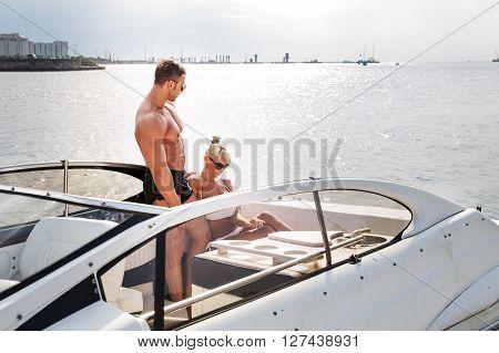 Elegant Beautiful Couple On A Boat In A Swim Wear