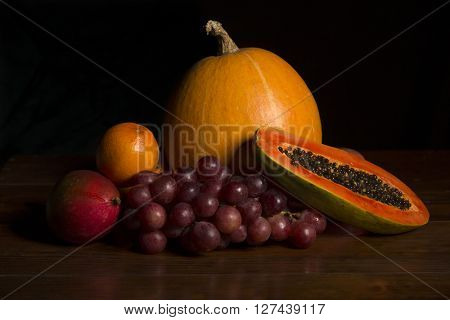 variety of fruits on a wooden table, studio picture