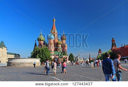 MOSCOW, RUSSIA - JUNE 05, 2013: Red Square with Spasskaya Tower in Moscow. The square got its present name Red Square in the 17th century