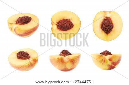 Cut open ripe nectarine half with a pit, composition isolated over the white background, set of six different foreshortenings