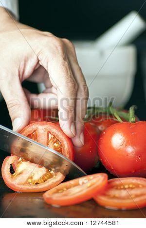 Chef Slicing Tomatoes