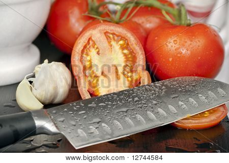 Knife with Tomatoes and Garlic