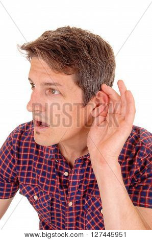A closeup image of a young man in a checkered shirt holding his hand behind his ear isolated for white background.