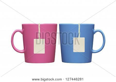 Two cups and tea bags with paper label isolated on white