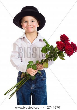 Festive little boy in black hat with bouquet of red roses, isolated on white