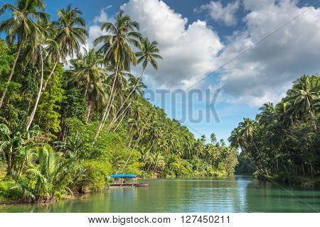 traditional fisherman boat  on a jungle green river Loboc at Bohol island of Philippines