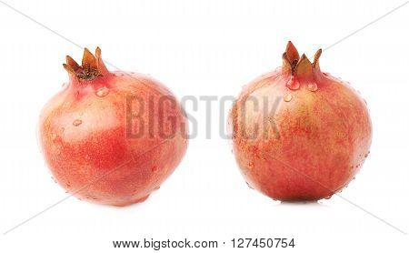 Pomegranate punica granatum fruit covered with multiple water drops isolated over the white background, set of two different foreshortenings