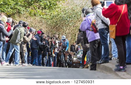 Conflans-Sainte-Honorine, France-March 6, 2016: The French cyclist Alexis Vuillermoz of AG2R La Mondiale Team riding during the prologue stage of Paris-Nice 2016.