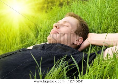 young man relax under summer sun