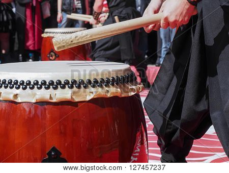 Musicians play drums outdoors. Culture of Korea Japan China