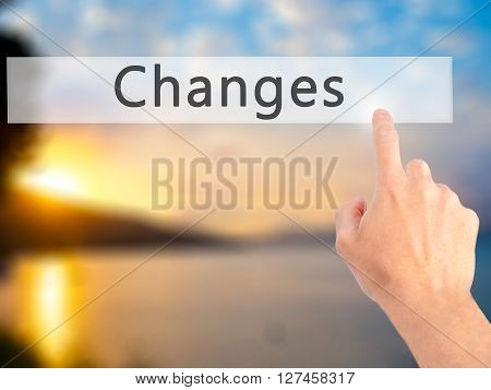 Changes - Hand Pressing A Button On Blurred Background Concept On Visual Screen.