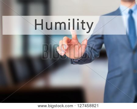 Humility - Businessman Hand Pressing Button On Touch Screen Interface.