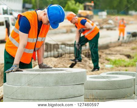 Exhausted Worker On Construction Site