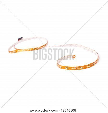 Brown tape of diodes over white isolated background
