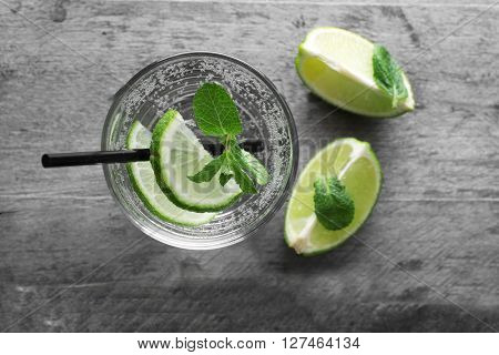 Glass of lemon soda on rustic wooden table
