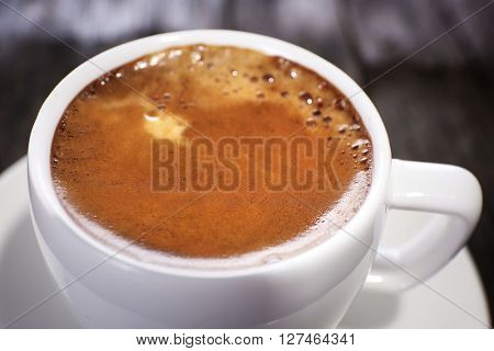 Cup of hot coffee, close up