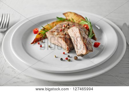 Delicious grilled steak on plate