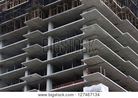 Seattle, WA - March 10, 2016: A construction worker works on an unfinished high-rise condo building in Seattle, WA.
