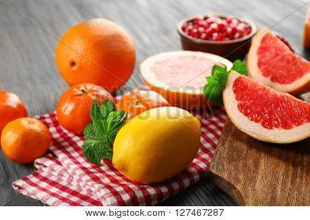 Juicy tropical fruits on wooden board, close up