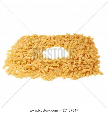 Round frame made of dry rotini yellow pasta over isolated white background