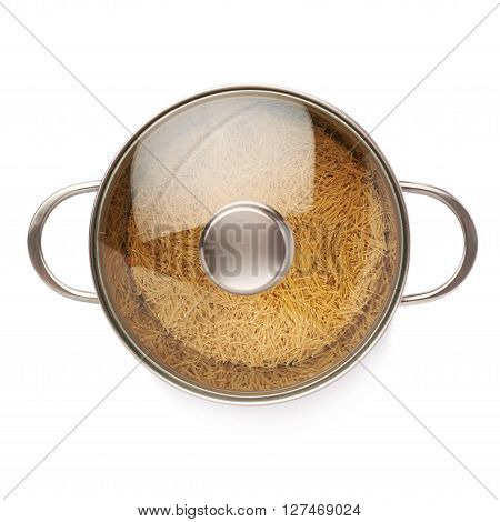 Metal pan with glass lid filled with dry noodles yellow pasta over isolated white background
