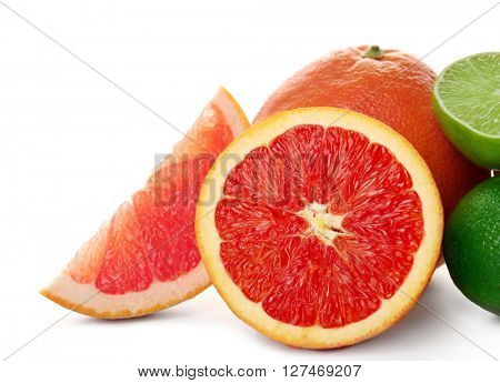 Mixed citrus fruit including grapefruits, orange and limes isolated on a white background, close up