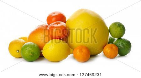 A heap of mixed citrus fruit including   lemons, limes, grapefruit, pomelo and tangerines isolated on a white background, close up