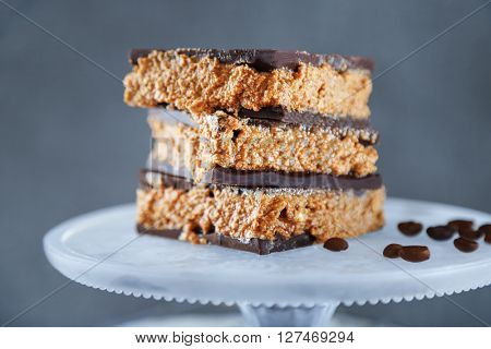 Tasty homemade cakes with chocolate on dark background, close up