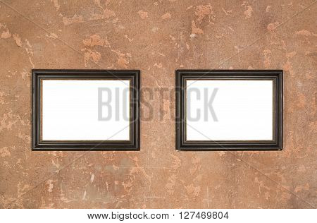 Two empty vintage brown frame on wall background