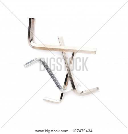 Pile of hex metal allen S and L keys over white isolated background