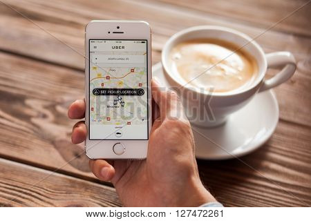 WROCLAW, POLAND - APRIL 12, 2016: Apple iPhone SE smartphone with Uber app on screen