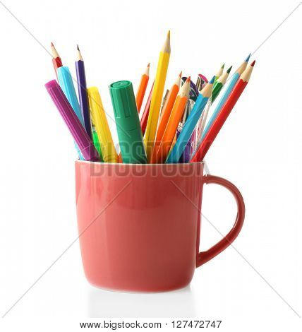 Colorful stationery in pink cup, isolated on white