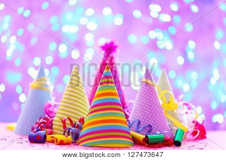 Party hats and other stuff on blurred garland background