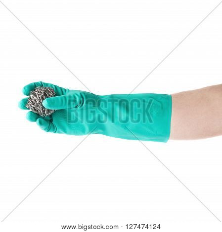 Hand in rubber latex green glove holding kitchen metal sponge over white isolated background
