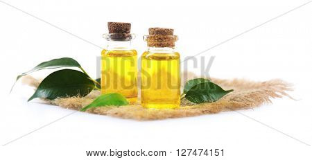 Bottles of tea oil, isolated on white