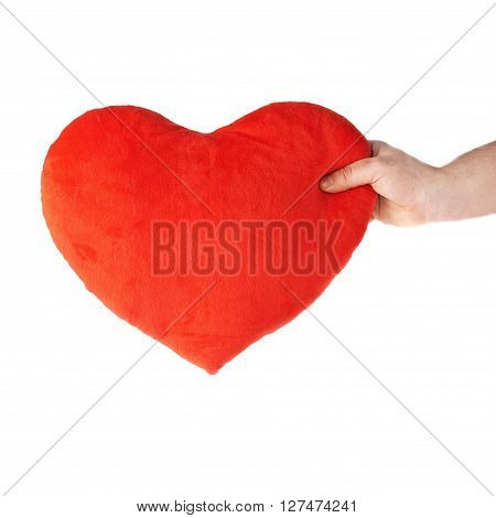 Gently holding plush red plush toy heart with one hand, composition isolated over the white background
