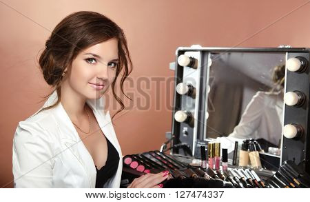 Beauty Smiling Woman Professional Stylist. Makeup Artist Over Dressing Room With Mirror. Attractive