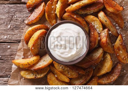 Potato Wedges And Mayonnaise Close-up On The Table. Horizontal Top View