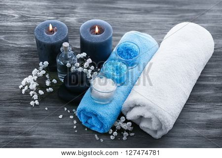 Spa still life with flowers and candlelight on wooden background