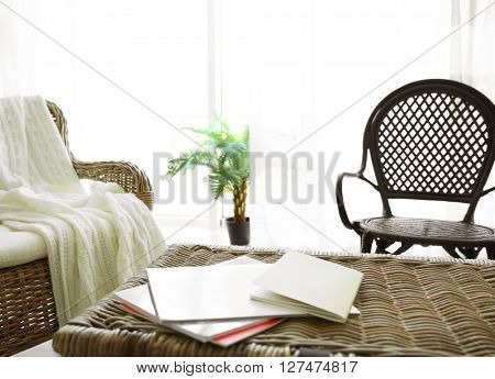 Modern living room interior with wicker furniture.