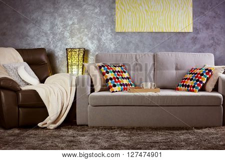 Design interior with sofa against grey wall background