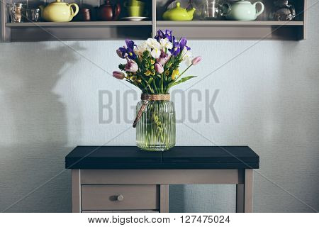 A bouquet of fresh flowers in a glass vase.