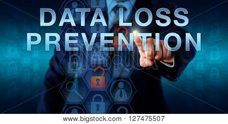 Administrator is pushing DATA LOSS PREVENTION on an interactive virtual touch screen. Information technology concept and data security metaphor for detection and monitoring of data leaks.